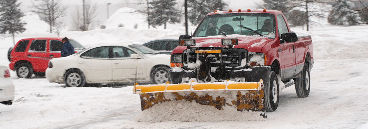 used snow plow on road