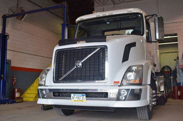 commercial truck repaired using diagnostic tools