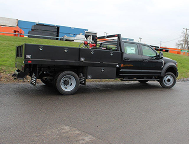 contractor truck with toolboxes and fuel transfer tank